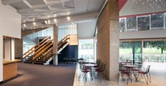 Chichester Festival Theatre foyer with painting by Antoni Malinowski and 'Play of Light' projection. Credit: Photo by Philip Vile.